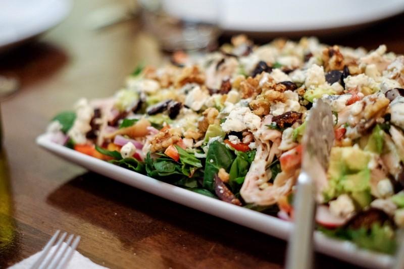 chicken on salad greens