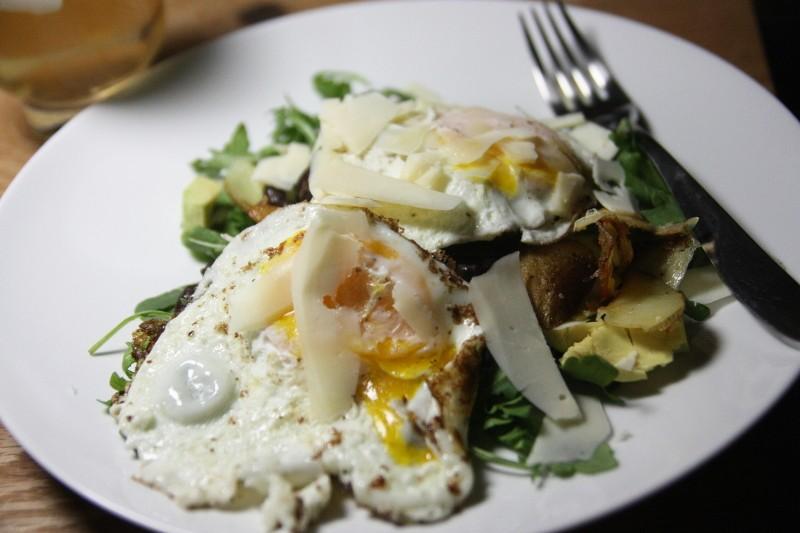 eggs & potatoes on greens
