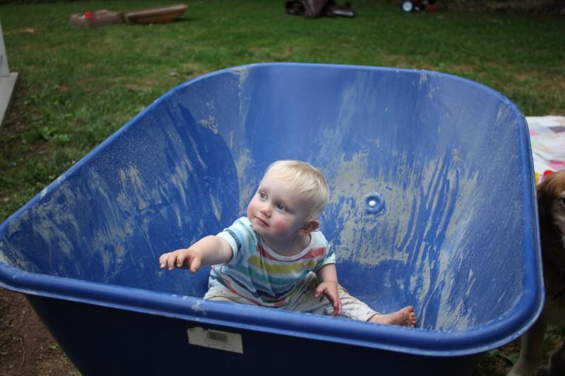 baby in wheelbarrow